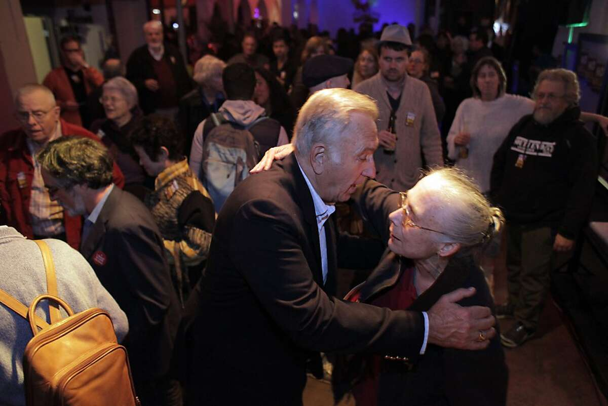 Former San Francisco Mayor Art Agnos hugs Linda Post as he arrives to the No on Props B&C headquarters on Tuesday. Opponents of Propositions B & C celebrate after results showed that both measures were defeated on Tuesday, November 5, 2013.