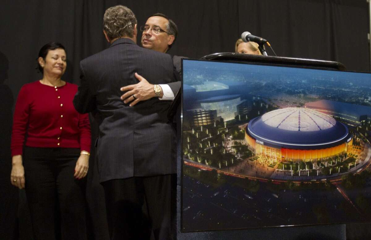 Harris County Judge Ed Emmett embraces Edgar Colon, chairman, Harris County Sports and Convention Corporation, after Emmett announced that the proposal to renovate the stadium was defeated Tuesday, Nov. 5, 2013, in Houston. Harris County voters struck down a $217 million proposal to renovate the Astrodome. ( Brett Coomer / Houston Chronicle )