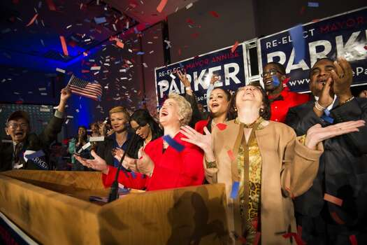 Houston mayor Annise Parker, center, celebrates her election victory with her partner Kathy Hubbard, right, during a campaign party at the  George R. Brown Convention Center on Tuesday, Nov. 5, 2013, in Houston. ( Smiley N. Pool / Houston Chronicle ) Photo: Smiley N. Pool, Houston Chronicle
