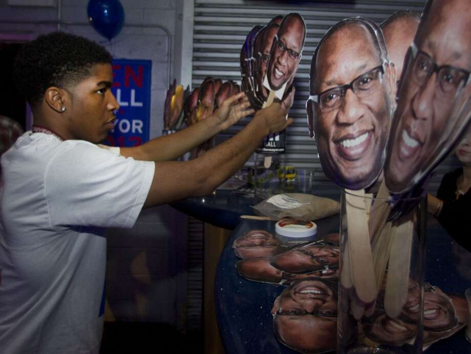Justin Elumn sets up for the election night party for Houston mayoral candidate Ben Hall Tuesday November 5, 2013 at the House of Dereon at 2204 Crawford St. in Houston, TX.  (Billy Smith II / Houston Chronicle) Photo: Billy Smith II, Chronicle