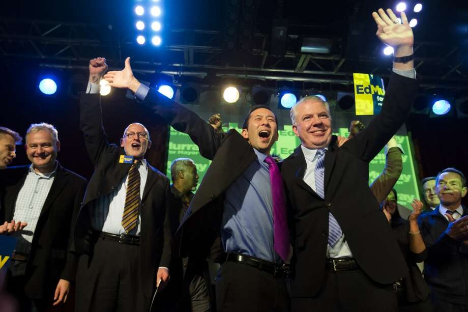 Ed Murray, right, and husband Michael Shiosaki, center, wave at supporters from the stage at Murray's election night party Tuesday, Nov. 5, 2013, at Neumos in Seattle. State Sen. Ed Murray took a big lead of 56 percent to 43 percent over incumbent Seattle Mayor Mike McGinn. Photo: JORDAN STEAD, SEATTLEPI.COM
