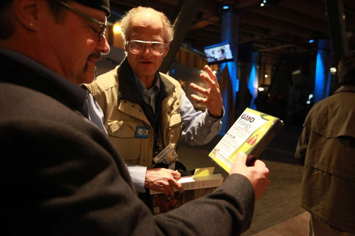 Tom Stahl, a local farmer and member of the Farmers and Friends of 522 group, shows a video about genetically modified foods during the Yes on 522 election party at the Impact HUB event space on Tuesday, Nov. 5, 2013.