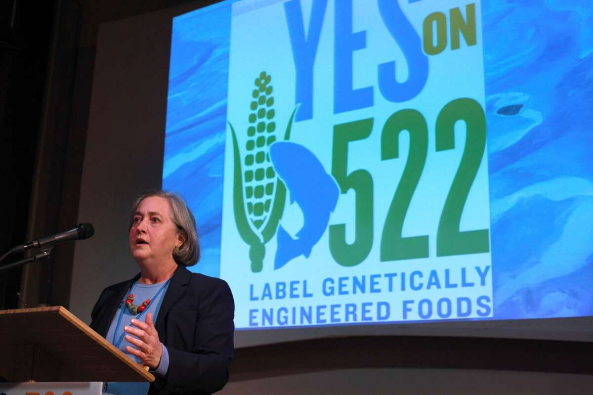 Trudy Bialic, co-author of initiative 522, which required labeling of genetically engineered foods, speaks to 2013 election night rally.  I-522 lost narrowly, but Attorney General Bob Ferguson has sued the Grocery Manufacturers Assn. for allegedly concealing the source of $11.3 million in food industry donations to the No on I-522 campaign.