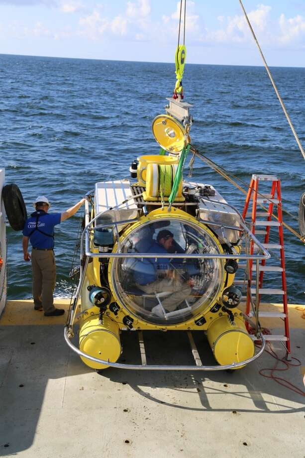 OceanGate's Antipodes submersible vessel, which holds five people, prepares to dive in the Gulf of Mexico to observe a rig that has become an artificial reef.