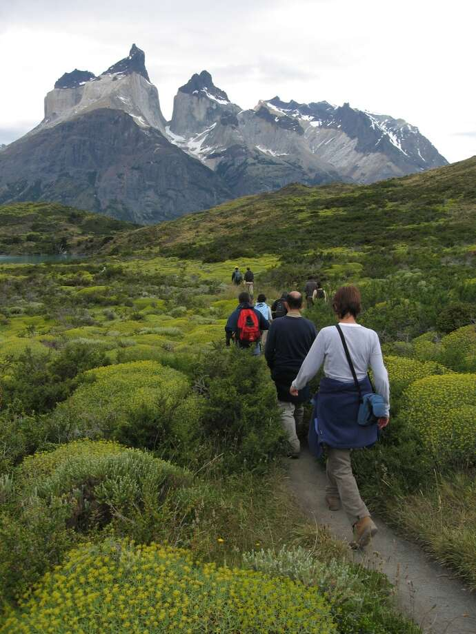 "Hikers in Torres del Paine National Park head toward Los Cuernos -- ""the horns."" Photo: John Flinn, The Chronicle"