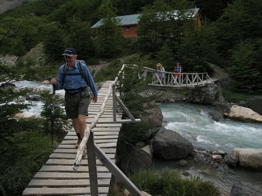 Hikers in Chile's Torres del Paine National park cross a bridge en route to the granite spires known as Los Torres. Photo: John Flinn, The Chronicle