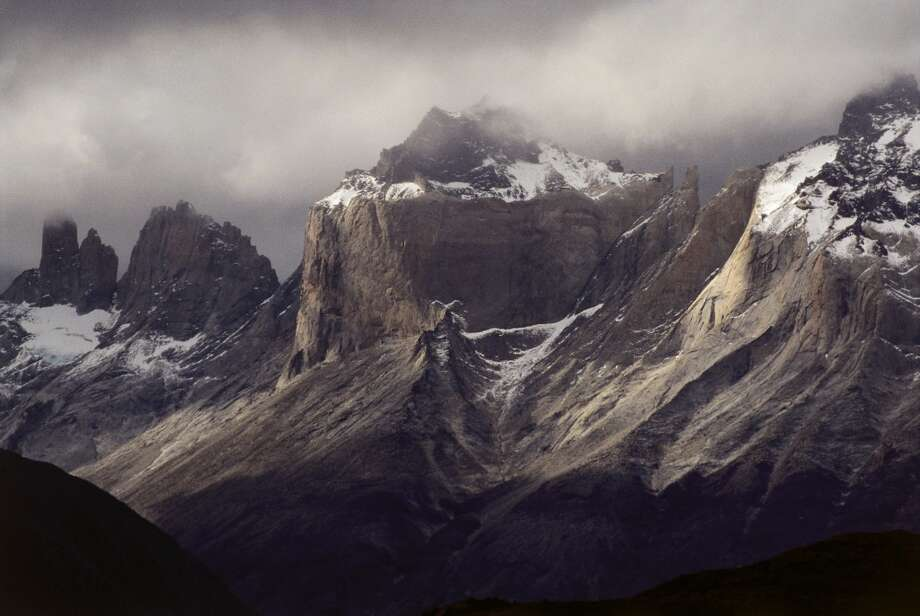 A stormy day in Patagonia casts a different light on the peaks of Torres del Paine National Park. Photo: IPS Lerner, UIG Via Getty Images