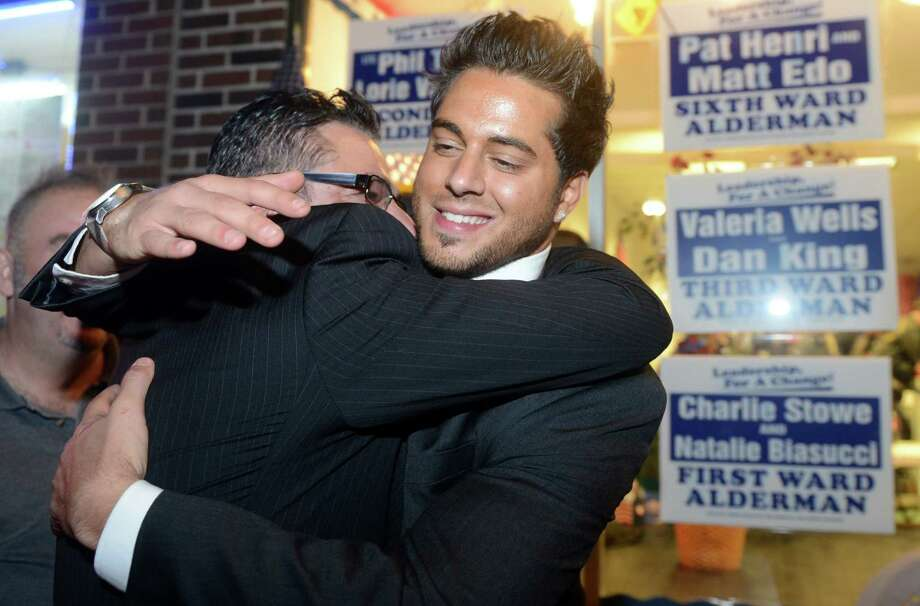 Republican mayor-elect David Cassetti and his son Anthony, a newly elected Alderman, hug Tuesday, Nov. 5, 2013 at Republican Headquarters in Ansonia, Conn. Photo: Autumn Driscoll / Connecticut Post