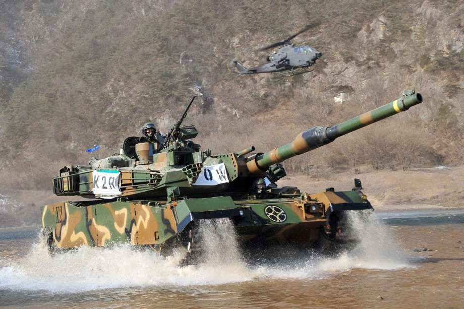 South Korea: K1A1 tank (seen here with a AH-1S helicopter) Photo: JUNG YEON-JE, AFP/Getty Images