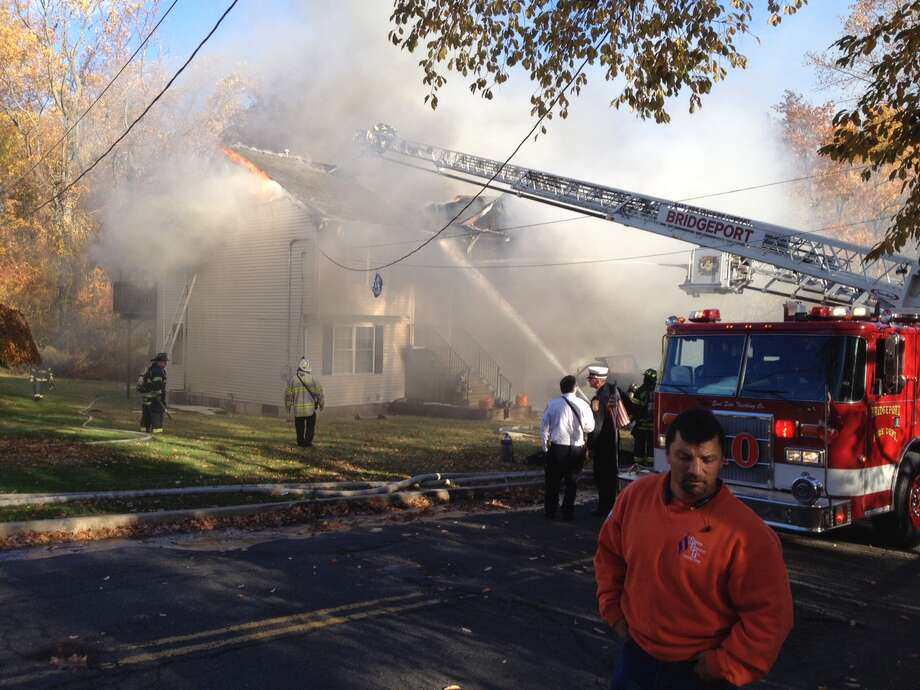 A fire heavily damaged a single-family home on 478 Woodrow Ave. in Bridgeport on Wednesday, Nov. 6, 2013. Photo: Frank Juliano, Connecticut Post / Connecticut Post
