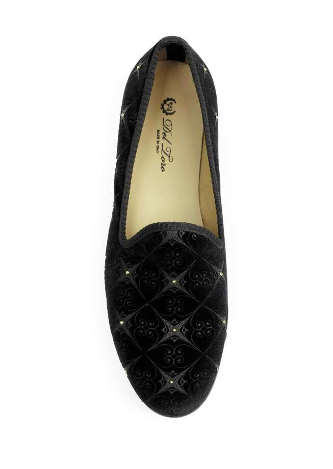 DEL TORO Velvet slipper with signature red stripe at back, $350-375. Photo: Courtesy Of Saks Fifth Avenue