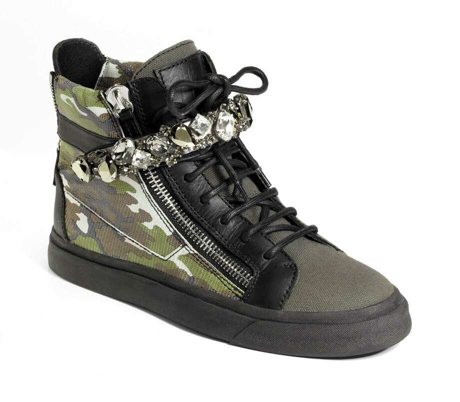 GIUSEPPE ZANOTTI Unisex canvas/leather hightops with Swarovski crystal bar, $1450. Photo: Courtesy Of Saks Fifth Avenue