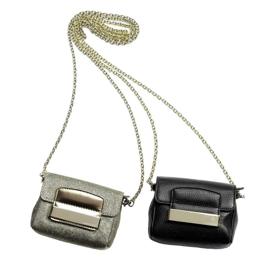 JIMMY CHOO Small flap bag with detachable cross-body chain, $895. Photo: Courtesy Of Saks Fifth Avenue