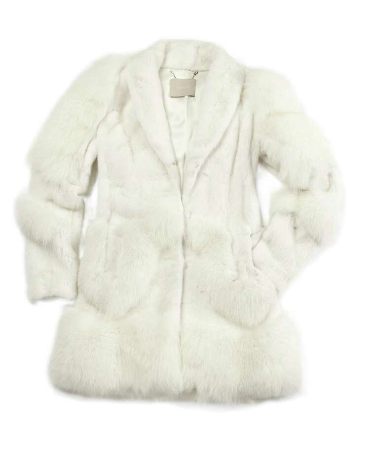 JASON WU Snow white fox fur coat with belt, $33,500. Photo: Courtesy Of Saks Fifth Avenue