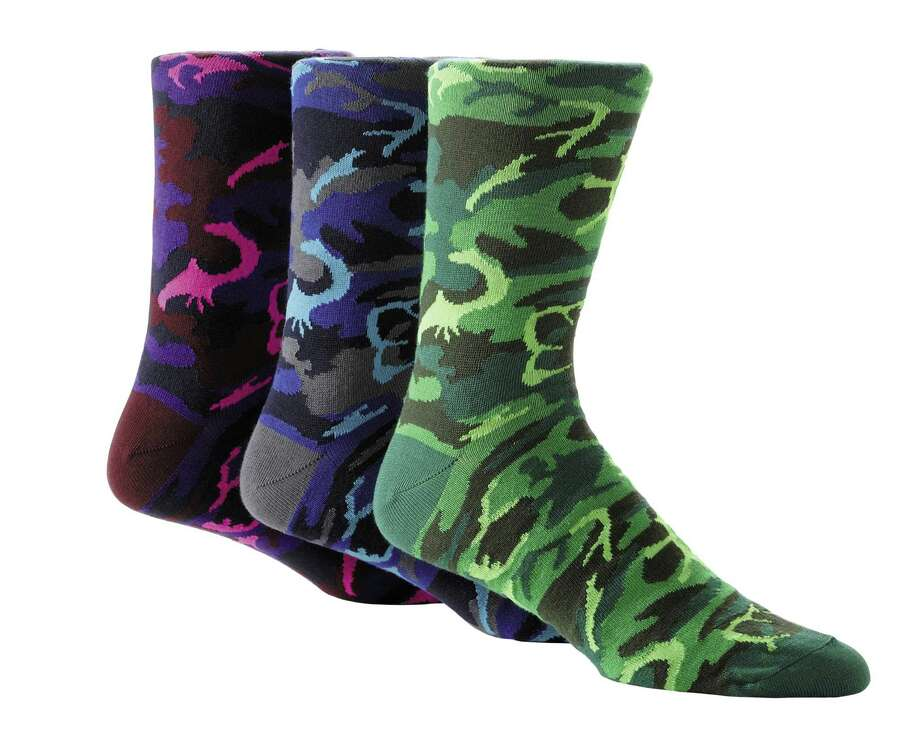 SAKS FIFTH AVENUE BLACK Camouflage colored socks with neon accents, $19.50. Photo: Courtesy Of Saks Fifth Avenue