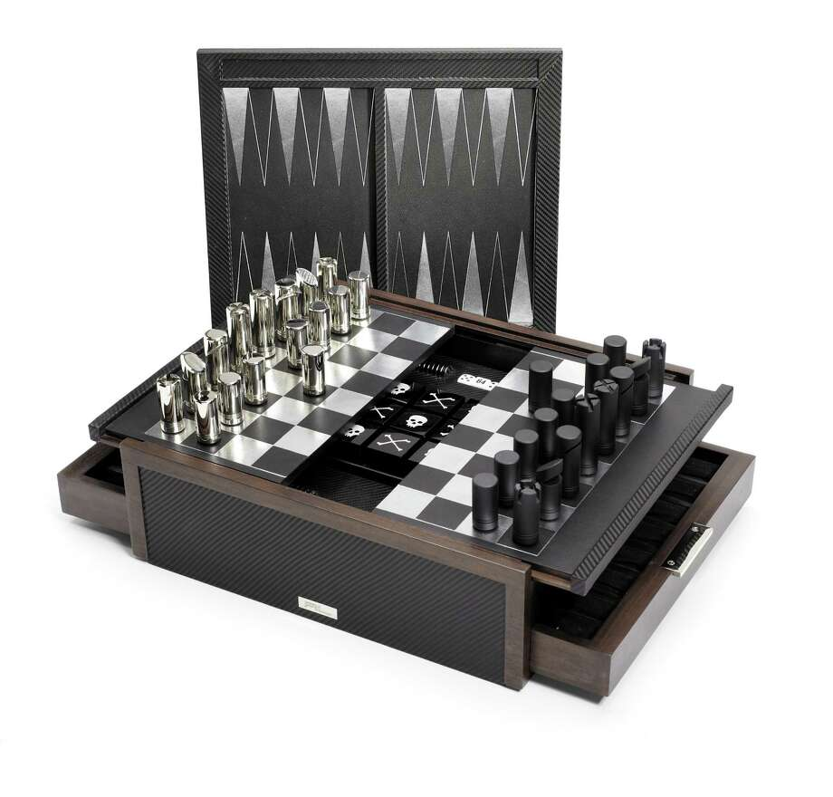 RALPH LAUREN HOME Black leather, walnut and carbon fiber five-in-one game box, $4995. Photo: Courtesy Of Saks Fifth Avenue