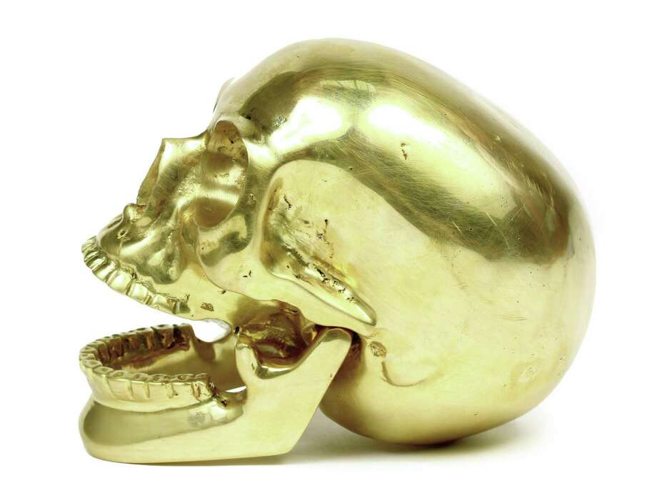KELLY WEARSTLER Brass hinged skull, $1795. Photo: Courtesy Of Saks Fifth Avenue