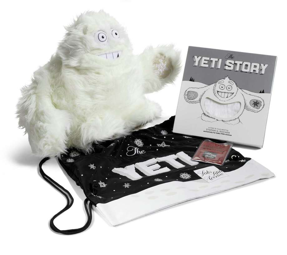 For years, it's been rumored that a Yeti lives on the roof of Saks Fifth Avenue, making snowflakes during the holiday season. He's been tracked by tourists and spotted by security cameras. Now, he's a holiday superstar, with a starring role in Saks Fifth Avenue's windows and light show, a plush toy ($55) and a furry book telling his story ($25). Photo: Courtesy Of Saks Fifth Avenue