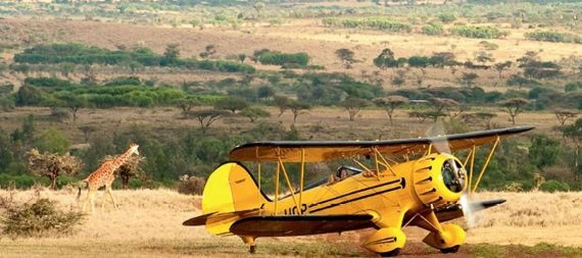Take a ride in a private helicopter over the Massai Mara in Kenya.