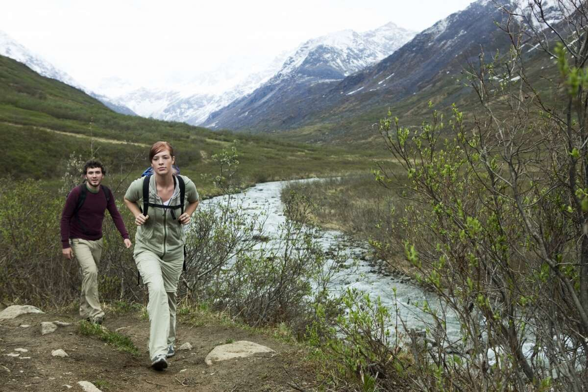 Go sightseeing in Alaska while hiking its mountainous terrain.