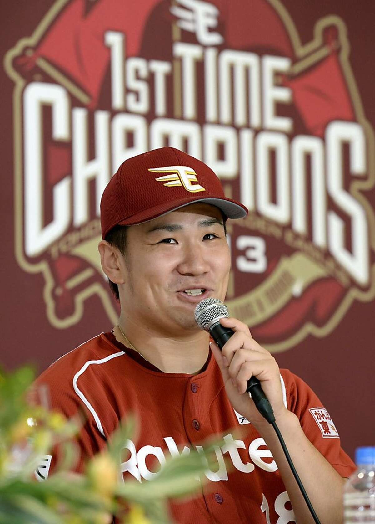 In this Thursday, Sept. 26, 2013 photo, Rakuten Eagles pitcher Masahiro Tanaka speaks at a news conference after defeating the Seibu Lions to clinch the team's first Pacific League franchise in Tokorozawa, Saitama Prefecture, northwest of Tokyo. Tanaka will be aiming to extend one of the most successful runs in the history of professional baseball when he takes the mound for the Rakuten Eagles in Game 1 of the Japan Series on Saturday, Oct. 26. (AP Photo/Kyodo News) JAPAN OUT, CREDIT MANDATORY