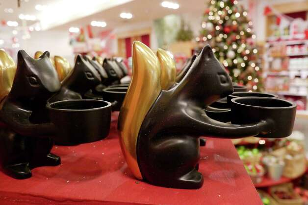 Squirrel tealight holders are seen Wednesday morning, Nov. 6, 2013, at The Tree Lot at Crate and Barrel store on the second level at Crossgates Mall in Guilderland, NY.  The holiday pop-up store was open through December 31st.   (Paul Buckowski / Times Union) Photo: Paul Buckowski / 00024526A