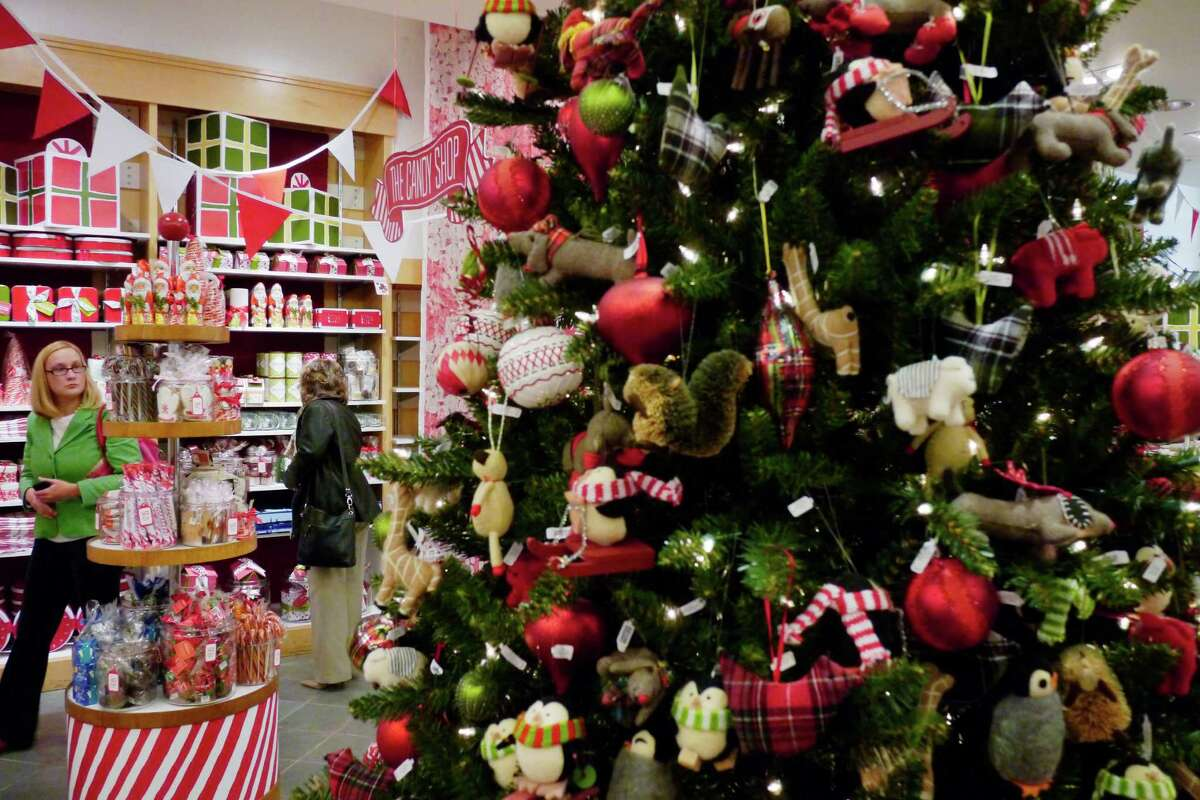 Shoppers look over the items at The Tree Lot at Crate and Barrel store Wednesday morning, Nov. 6, 2013, on the second level at Crossgates Mall in Guilderland, N.Y. The holiday pop-up store will be open through December 31st. (Paul Buckowski / Times Union)