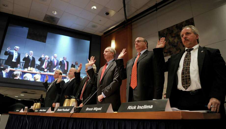 The first panel of witnesses are sworn in prior to testifying before the National Transportation Safety Board (NTSB) investigative hearing in Washington, Wednesday, Nov. 6, 2013.on two recent Metro-North Railroad accidents that occurred in Connecticut. From left are, Gary Carr with the Federal Railroad Administration, Kenneth Rusk with the Federal Railroad Administration, Robert Florom with the Transportation Technology Center, Inc., Robert Puciloski with Metro-North Railroad, Bruce Wigod, with New Jersey Transit, and Rick Inclima with the Brotherhood of Maintenance of Way Employees. Photo: Susan Walsh, AP Photo/Susan Walsh / Associated Press AP Photo/Susan Walsh
