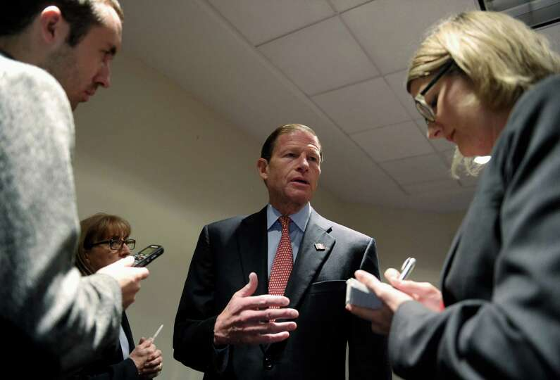 Sen. Richard Blumenthal, D-Conn., center, speaks with reporters before the start of a National Trans