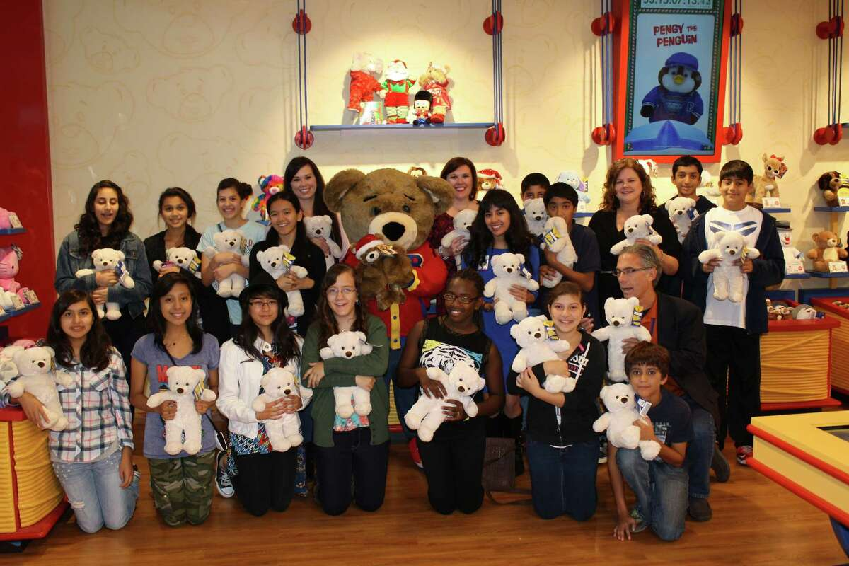 Straight A students from Briarmeadow Charter School, pictured with representatives from Children's Memorial Hermann-Memorial City, show off the bears they made to donate to Children's Memorial Hermann-Memorial City.