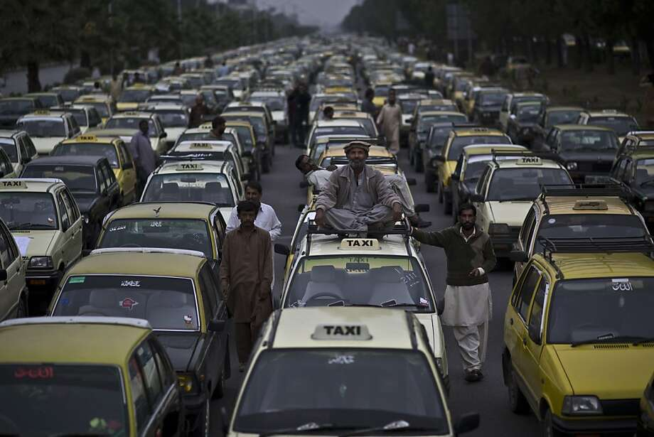 And you thought San Francisco's Critical Mass was bad:Taxi drivers block a main thoroughfare in Islamabad   during a protest near parliament in Islamabad. The cabbies were protesting the Pakistani traffic police for   reasons the photographer did not feel compelled to include. Photo: Muhammed Muheisen, Associated Press