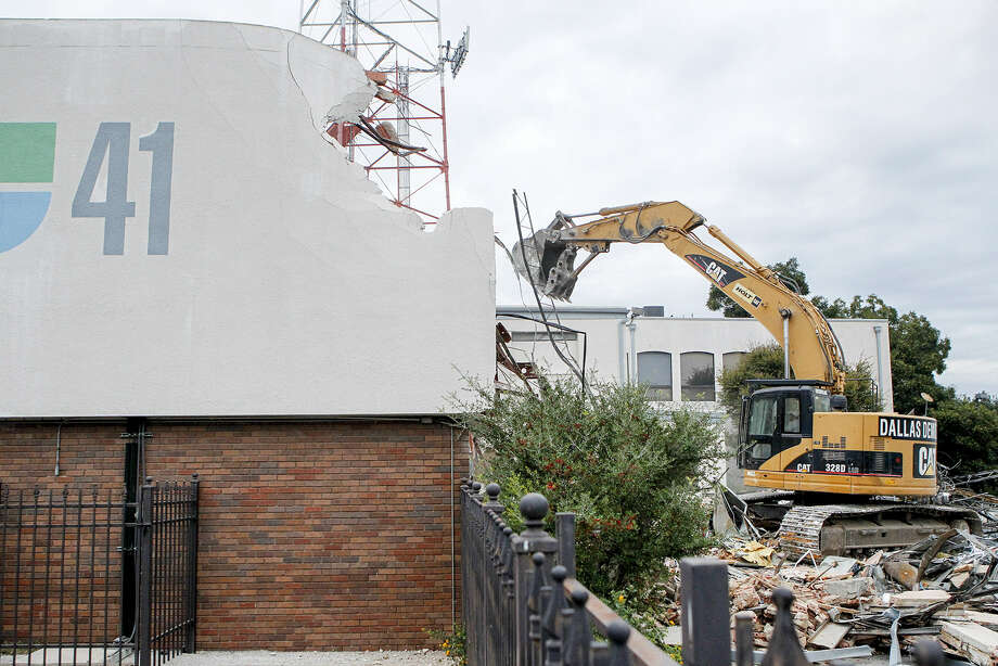 Demolition of the former KWEX 41/Univision building began on Nov. 4, but the work was halted less than 24 hours later after preservationists sought a restraining order to stop its destruction. Photo: Marvin Pfeiffer/ San Antonio Express-News