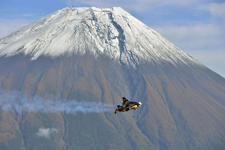 "Who needs an airplane? Not Swiss pilot Yves Rossy, a.k.a. ""Jetman."" Equipped with jet engine-powered wings, the aviator circled Japan's Mount Fuji nine times in one week. Photo: Katsuhiko Tokunaga, AFP/Getty Images"