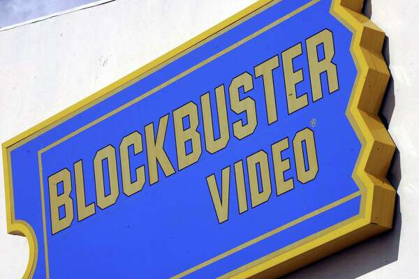 A sign from a Blockbuster Video store in Dallas is shown, Tuesday, Nov. 8, 2005. Blockbuster Inc., the nation's biggest movie-rental chain, on Tuesday posted a hefty third-quarter loss as charges and tighter margins due to cutting late fees weighed on its bottom line.