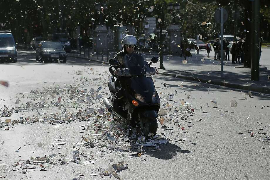 It's only day oneof a sanitation workers and street cleaners strike in Madrid, and already the streets are filling with litter. Photo: Andres Kudacki, Associated Press