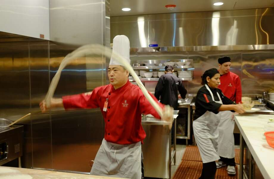 A chef hand pulls noodles in the kitchen of the M.Y. China restaurant at the Graton Resort and Casino in Rohnert Park. Photo: Eric Risberg, Associated Press