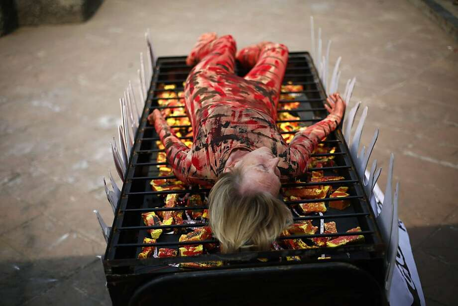 "Barbecued protester: Animal-rights activist and PETA co-founder Ingrid Newkirk is ""grilled"" in Mumbai to 