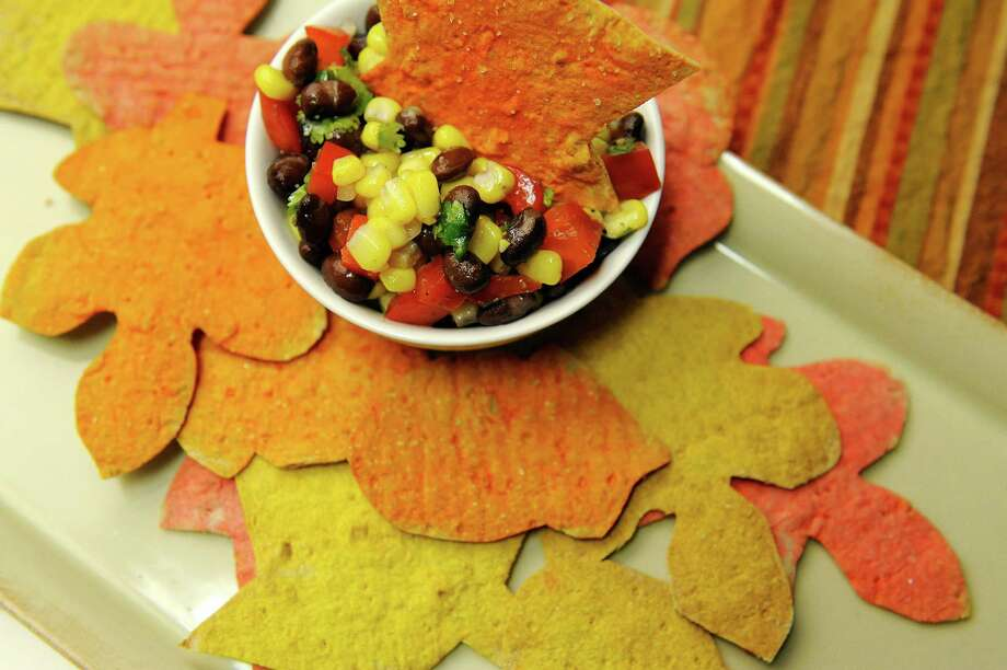 Corn salsa and flat bread in the shapes of leaves made by Jodie Fitz, the Kids Cuisine writer, photographed at the Times Union on Wednesday, Oct. 16, 2013 in Colonie, NY.   (Paul Buckowski / Times Union) ORG XMIT: MER2013101611595913 Photo: Paul Buckowski / 00024158A