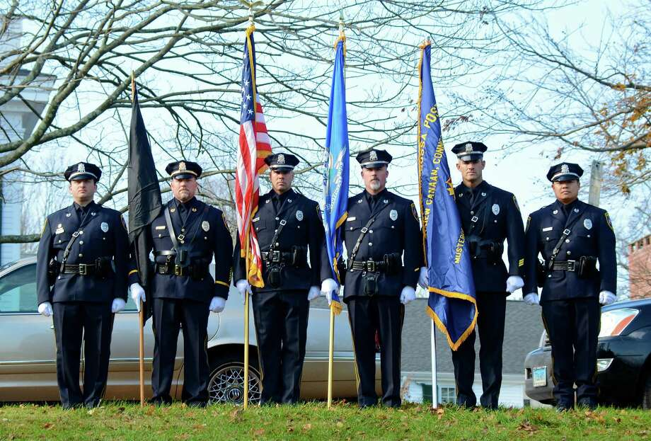 New Canaan Police officers prepare to present the colors at last year's Veterans Day ceremony. This year the ceremony will take place at 10:55 a.m. on Monday, Nov. 11 at God's Acre. Photo: Jeanna Petersen Shepard / New Canaan News