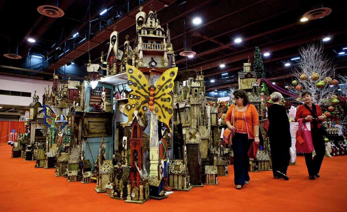 Elsa Villarreal, of Houston, browses through a collection of miniature churches during the 2012 Nutcracker Market's preview night, Wednesday, Nov. 7, 2012, in Houston. The Market will continue until Sunday the 11th.( Nick de la Torre / Houston Chronicle )