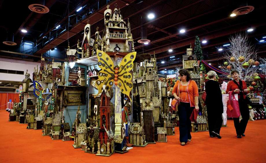 Elsa Villarreal, of Houston, browses through a collection of miniature churches during the 2012 Nutcracker Market's preview night, Wednesday, Nov. 7, 2012, in Houston. The Market will continue until Sunday the 11th.( Nick de la Torre / Houston Chronicle ) Photo: Nick De La Torre, Staff / © 2012  Houston Chronicle