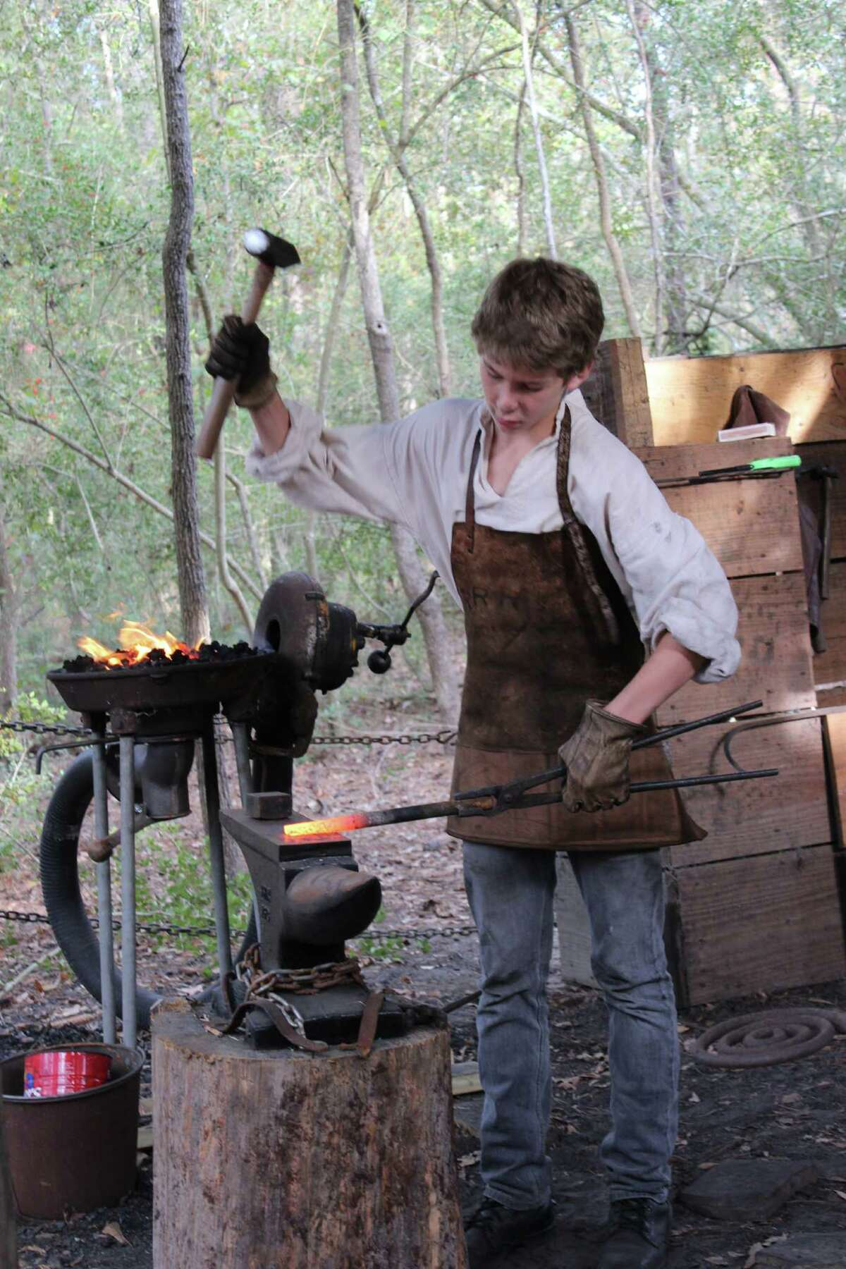 Costumed re-enactors, such as blacksmith James Yordy, will be featured at Pioneer Day.