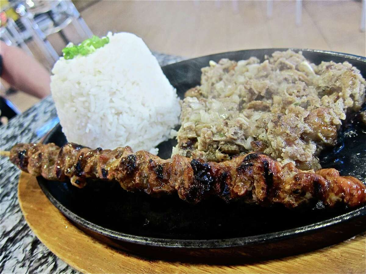 The sizzling sisig plate at Jonathan's comes with a pork barbecue skewer and rice.
