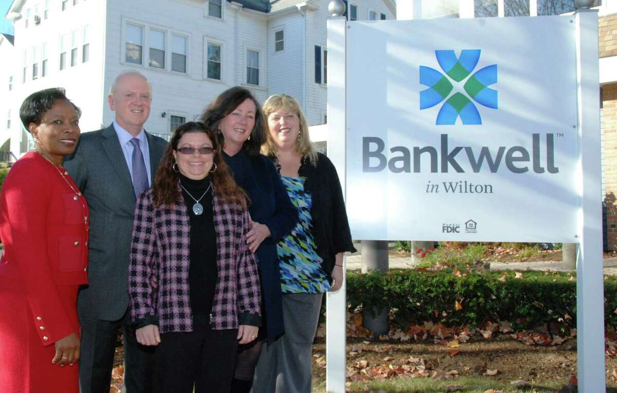 Marking the merger of the Wilton Bank into the Bankwell family are, from left, Gail Brathwaite, chief operating officer; John Friend, senior vice president; Tracy Thorndike, assistant branch manager; Peyton Patterson, CEO; and Melissa Mednick, branch manager.