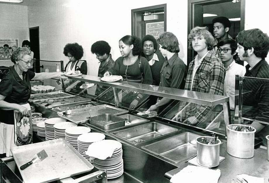 Some things probably don't change, like standing in line in the Roosevelt High School cafeteria. Photo is from 1973.  Photo: P-I File