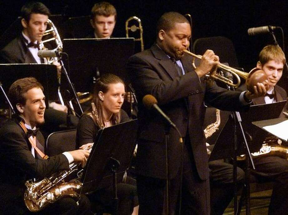 Roosevelt is also known for its award-winning Jazz Ensemble. Pictured is the band in 2000 at Lincoln Center at the prestigious Essentially Ellington festival in New York, where the students got to perform with Wynton Marsalis, standing.  Photo: P-I File