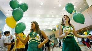The September 2006 photo caption read: Cheerleaders Elise Hansen (left), a junior, and Fiona Gleason, a senior, hand out balloons during freshman orientation at the newly renovated Roosevelt High School.