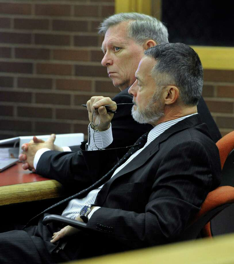Robert Bell, with his attorney, John Gulash, right, listens to questioning during the first day of his manslaughter trial at Danbury Superior Court, Wednesday, Nov. 6, 2013.  Bell is accused of fatally shooting his wife. Photo: Carol Kaliff / The News-Times
