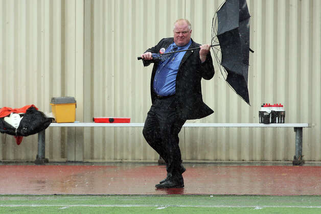 September 14 2010. Rob Ford loses his umbrella in the storm.  Rob Ford coached his Don Bosco football team to a win in the rain on Thursday. Photo: RENE JOHNSTON, TORONTO STAR / TORONTO STAR