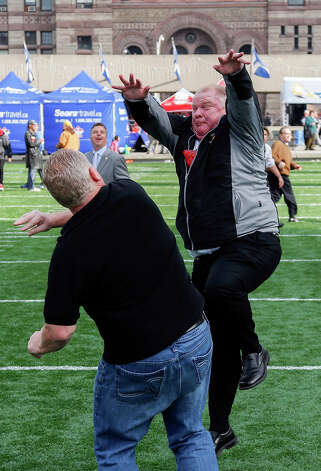 TORONTO, ON - NOVEMBER 20:  Mayor Rob Ford goes up to block a pass from brother Doug Ford during Grey Cup celebrations at the CFL Adrenaline Zone at Natha